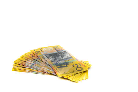 Stack of Australian 50 dollars banknotes isolated over white background with copy space, cash is king concept image