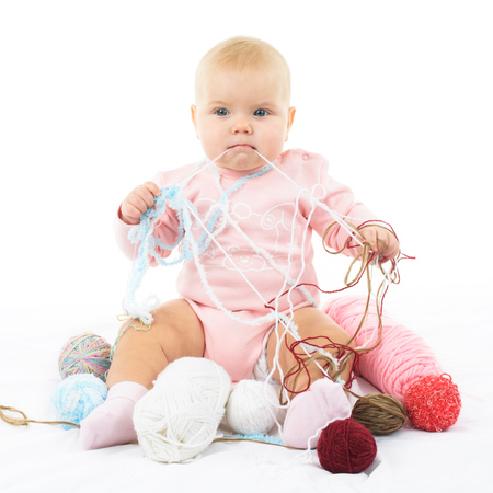 girl with colored thread Stock Photo