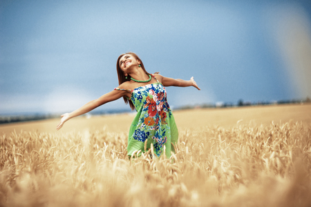 girl in wheat meadow
