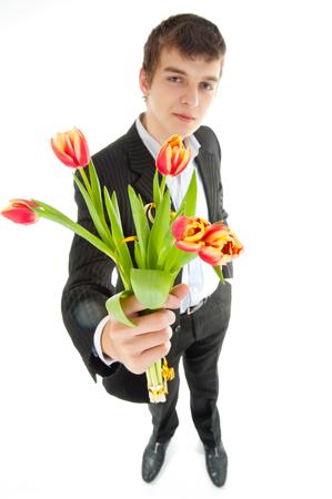 Businessman offering tulip