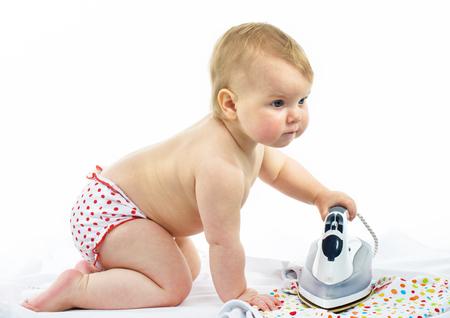 Little girl  ironing Stock Photo