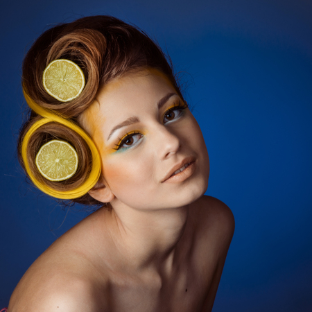 visage: woman with fruit in hair