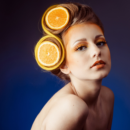 woman with fruit in hair