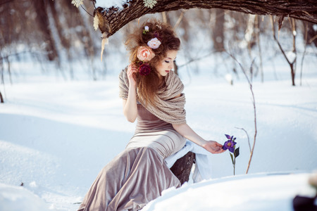 beautiful girl in the winter forest Stock Photo
