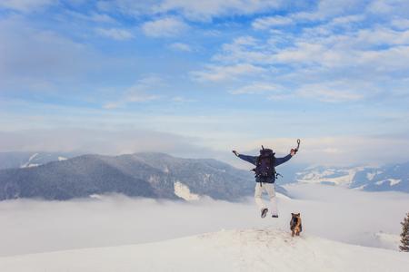 tourist jumps off the mountain Stock Photo