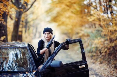 Sexy blonde girl with weapon Stok Fotoğraf