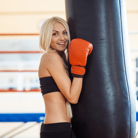 Pretty sport woman with boxing gloves Stock Photo