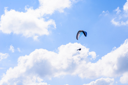 Skydiver in the clear sky Stock Photo