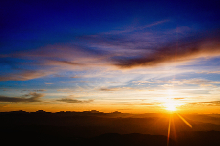 colorful sky with sun background in mountains