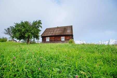 haycock: landscape with colorful tree and house Stock Photo