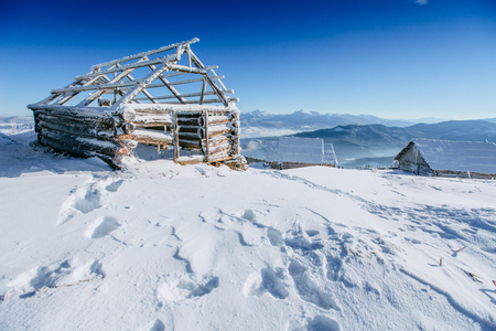 wintersport: cabin in the mountains in winter