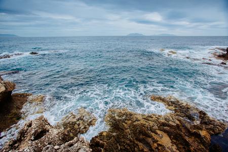 salina: Scenic rocky coastline Cape Milazzo.Sicily, Italy.