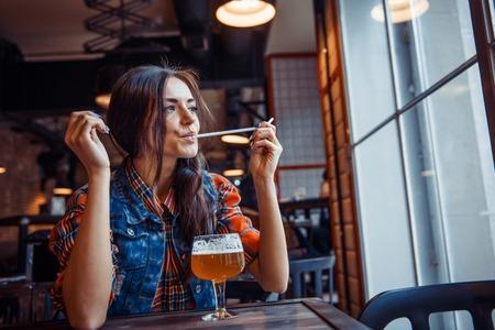 art processing: Beer woman enjoying a fresh draft  on cafe. Art processing Stock Photo