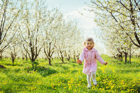 art processing: child outdoors in the blossom trees. Art processing and retouchi