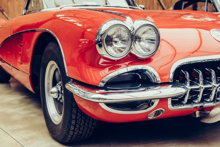 closeup of the headlights and front bumper on  vintage automobile 스톡 콘텐츠