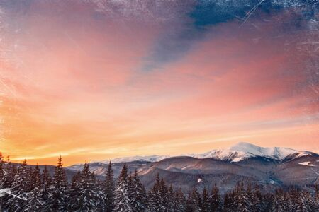 effect sunset: Magic sunset in the snowy mountains. Vintage effect. Stock Photo