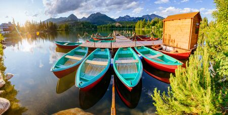 paddles: Boat on the dock surrounded mountains. Fantastic Shtrbske Pleso
