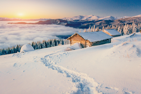 chalets in the mountains at sunset