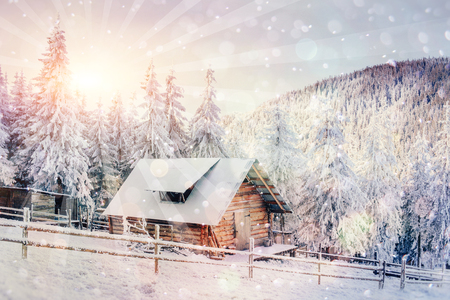 chalets in the mountains at sunset. Winter greetings Stock Photo