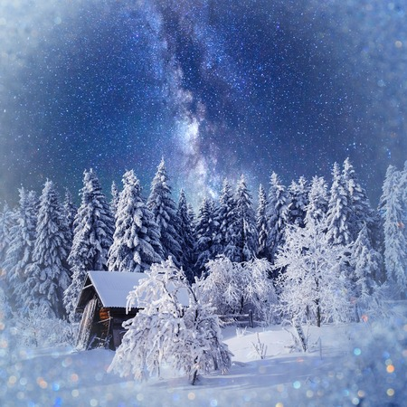 fantastic winter landscape. Chalet under the stars. background w Stock Photo
