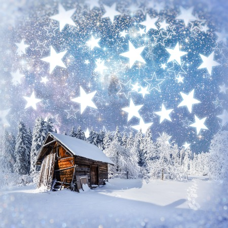 fantastic winter landscape. Chalet under the stars. Stock Photo
