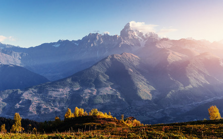 caucas: Autumn landscape and snow-capped mountain peaks. View of the mountain