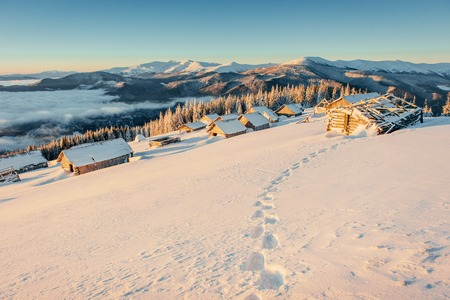 Footprints leading to the chalets in the mountains