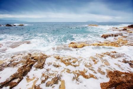 salina: Scenic rocky coastline Cape Milazzo. Sicily, Italy