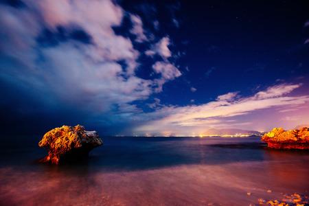 The starry sky above rocky mountains. Stock Photo
