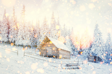 cabin in the mountains in winter,