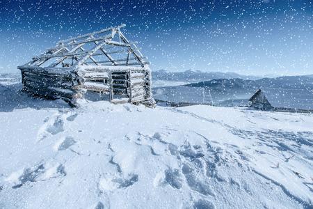 chalet in the mountains. Carpathian, Ukraine, Europe. Bokeh light Stock Photo