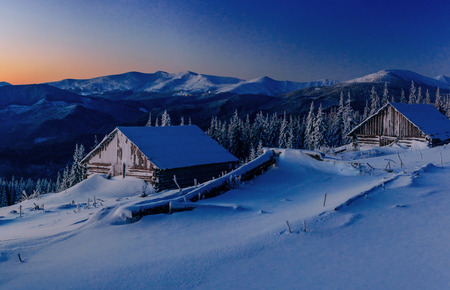 Fantastic winter landscape. Magical sunset in a frosty day.