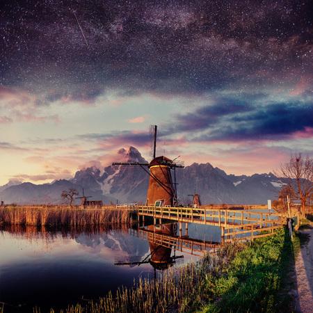 Fantastic Shtrbske Pleso High Tatras. Dutch mill at night. Stock Photo