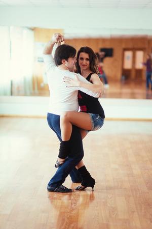 Beautiful couple of professional artists dancing passionate danc Stock Photo