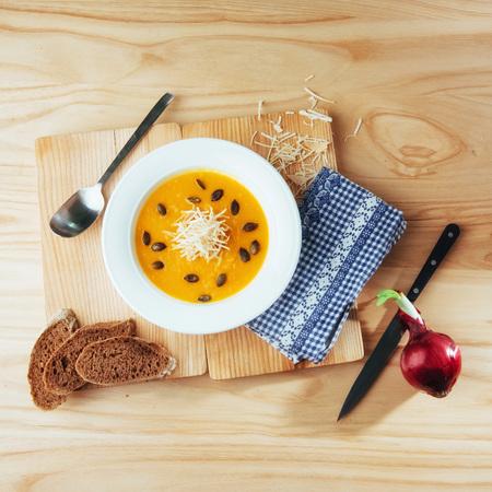 dietary: Pumpkin soup in white bowl, dietary vegetable
