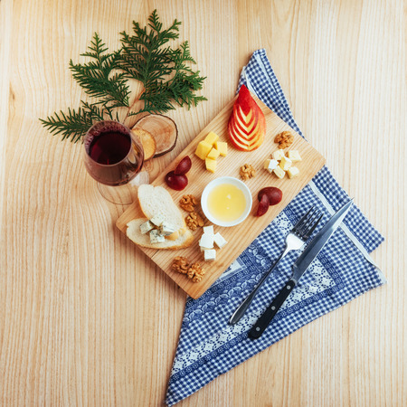 cheeseboard: Red Wine And Assorted Cheese Plate with fruit