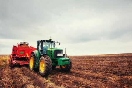 ploughing: Tractor plowing farm field in preparation for spring planting