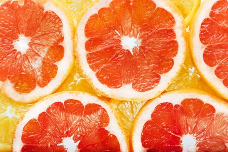 background of citrus fruits oranges and grapefruit slices. Studi Stock Photo