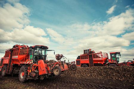 ploughing: tractors working in the field. Carpathians. Ukraine Europe