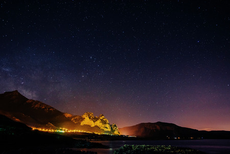 Starry Sky over the city by the sea Sicily. Italy