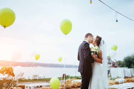 Beautiful young couple kissing wedding, blonde bride with her gr