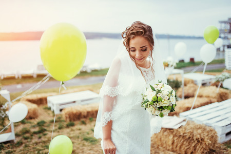 Beautiful brunette bride in a white dress at wedding