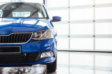 The headlights and hood Blue sports car.