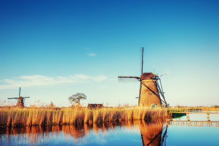 holland windmill: Traditional Dutch windmills from the channel Rotterdam. Holland Stock Photo