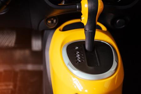 reversing: manual shift of modern car gear shifter. Stock Photo
