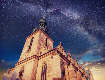 stale: Architecture outside church. Night time starry sky. Retro stale.