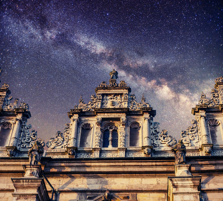 Architecture outside church. Night time starry sky. Retro stale.