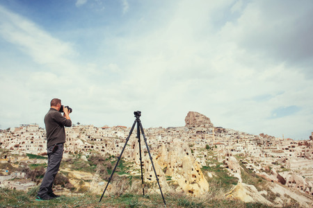 natural formation: man photographs the ancient city Stock Photo