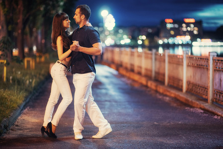 young couple dancing tango on the embankment Stock Photo