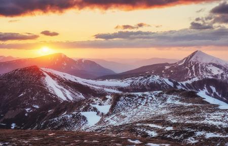 kanchanaburi: Colorful spring sunset over the mountain ranges in the national park Carpathians. Ukraine, Europe.